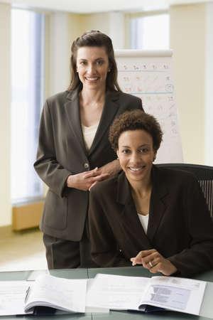 daydreamer: Multi-ethnic businesswomen at table