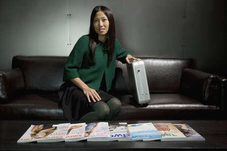 radio activity: Asian businesswoman sitting on sofa