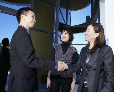 Asian businesspeople shaking hands Stock Photo