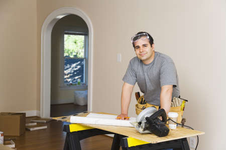 filipino ethnicity: Hispanic man remodeling interior of home
