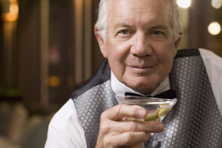 eveningwear: Close up of senior man drinking cocktail