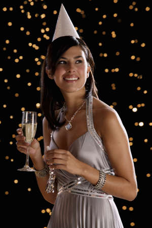 south american ethnicity: Hispanic woman drinking champagne on New Years Eve
