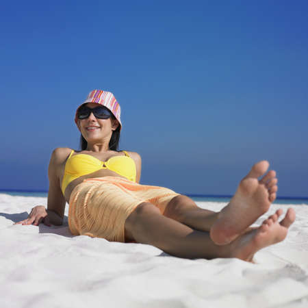 unconcerned: Woman sitting on beach