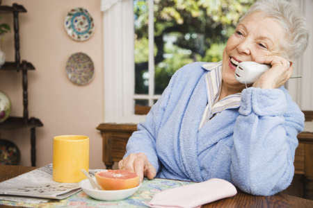 late forties: Senior woman talking on telephone