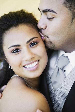davenport: Multi-ethnic couple hugging