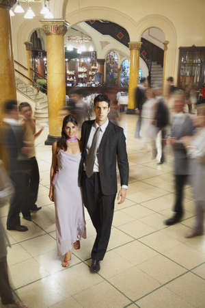 'evening wear': Young Hispanic couple in evening wear