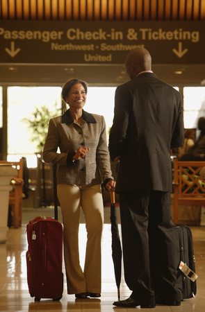 ticketing: Multi-ethnic businesspeople talking at airport LANG_EVOIMAGES