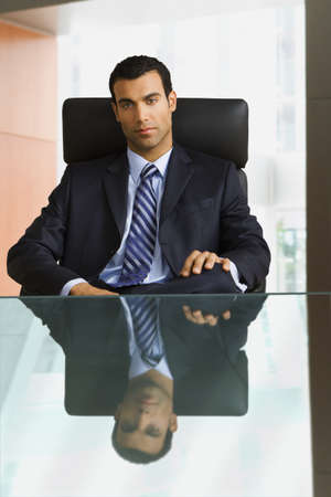 daydreamer: Hispanic businessman sitting at desk