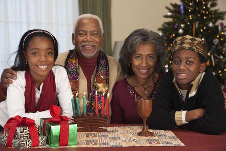 kwanzaa: African couple with grandchildren celebrating Kwanzaa LANG_EVOIMAGES