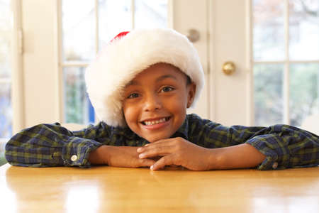 African boy wearing Santa hat