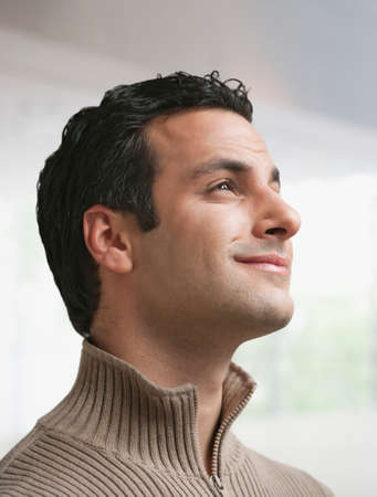 inner strength: Mixed race man looking up and smiling