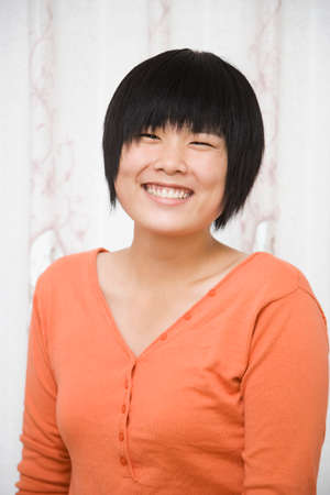 one teenage girl only: Chinese girl smiling LANG_EVOIMAGES