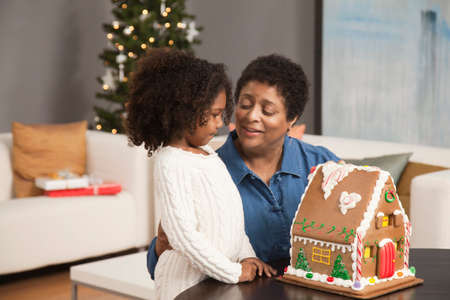 standoff: Grandmother and granddaughter looking at gingerbread house