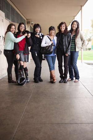 latina america: Students standing in school corridor LANG_EVOIMAGES