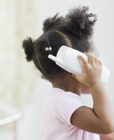 acknowledging: African American girl playing with toy phone