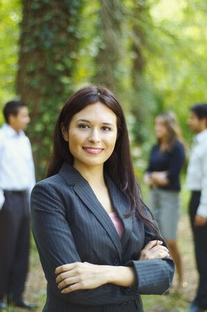 Hispanic businesswoman posing with arms crossed