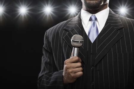 well beings: African American man holding microphone