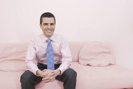 drizzling rain: Hispanic businessman sitting on sofa