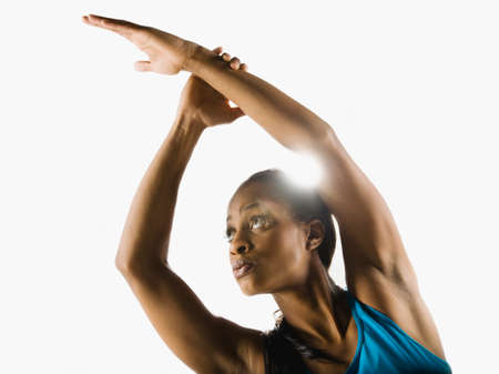 jamaican adult: Mixed race woman stretching arms overhead