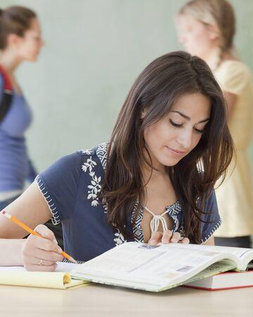 irish ethnicity: Hispanic woman studying in classroom