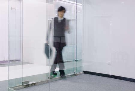 standpoint: Businessman entering through a glass door (blur), Beijing, China