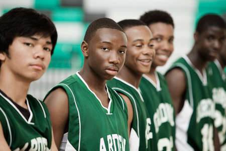 sports uniform: Basketball players standing in row