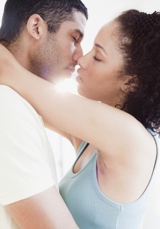 passionately: Couple kissing passionately LANG_EVOIMAGES