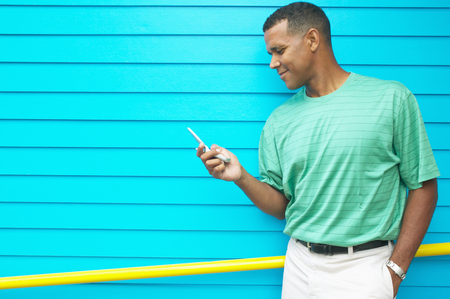 Mid adult man holding a mobile phone Stock Photo