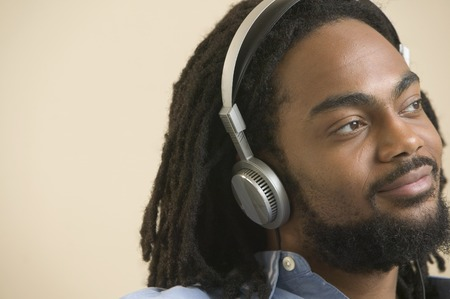 Young man wearing headphones listening to music