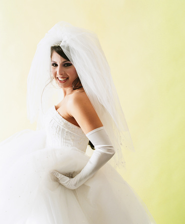 Portrait of a young woman wearing a bridal gown smiling Stock Photo