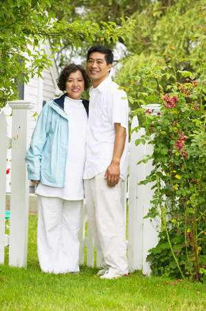 Portrait of a couple standing together on a lawn Stock Photo