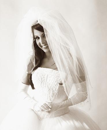 Portrait of a young bride smiling Фото со стока