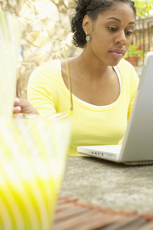 Young woman sitting at a table in front of a laptop