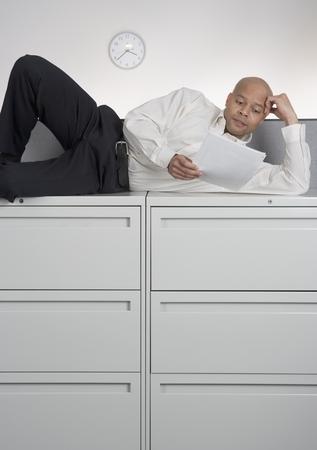 Mid adult man lying on his side Фото со стока