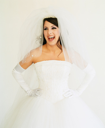 Young woman wearing a bridal outfit smiling
