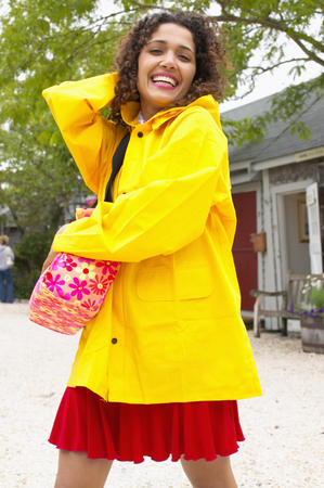 Portrait of a young woman holding a bag smiling Stock Photo