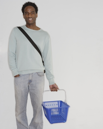 Portrait of a mid adult man holding a basket