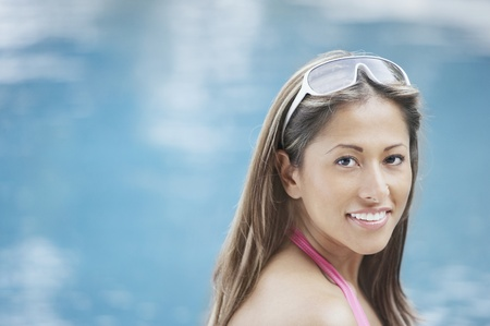 Smiling young woman in swimwear Stock Photo