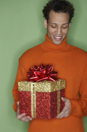 Young man holding a gift