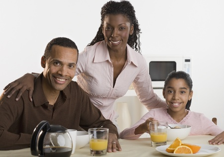 Portrait of family at breakfast table