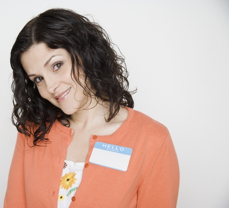 Portrait of woman with name tag on Stock Photo