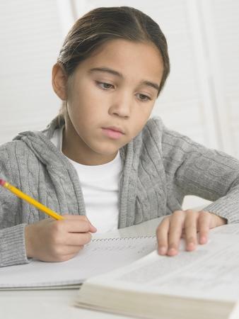 Young girl doing her homework