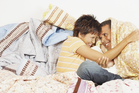 Young couple relaxing among blankets
