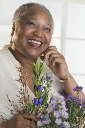 Senior woman receiving flowers