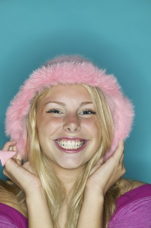 Close up of girl wearing pink hat and smiling Stock Photo