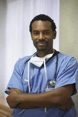 African male surgeon with arms crossed