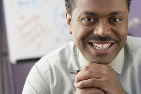 Close up of African businessman smiling Stock Photo