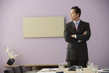 Asian businessman with arms crossed Stock Photo