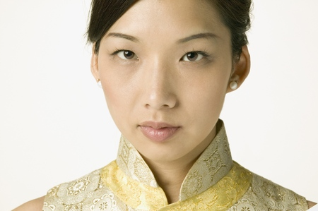Young Asian woman in traditional clothes posing for the camera Stock Photo