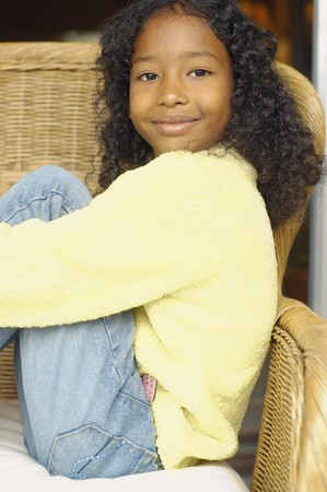 African American girl sitting in chair